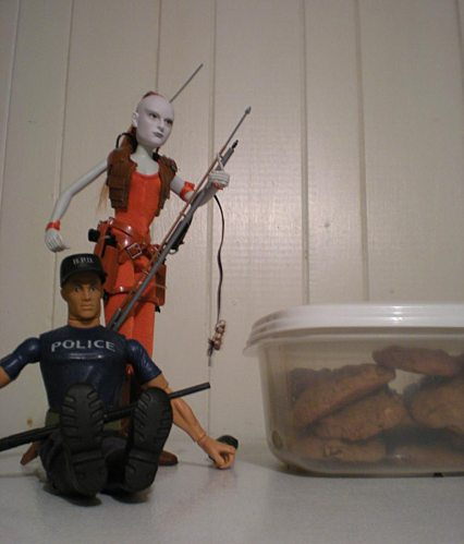 As we all know, small men spend a great deal of their free time stealing cookies. Mine, however, are well guarded by armed action figures. Attempt to steal at your own peril.